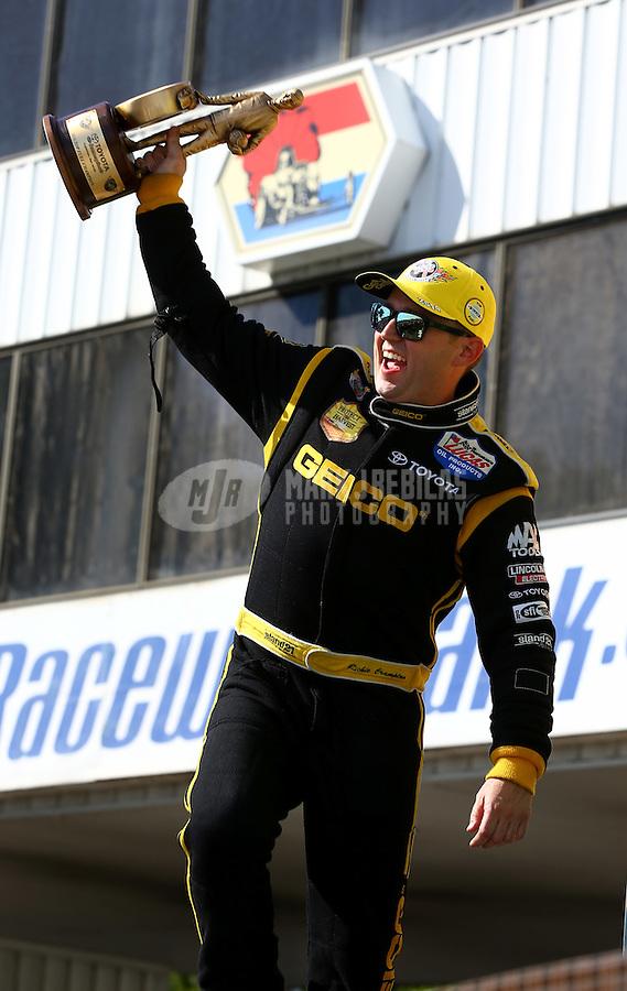 Jun. 1, 2014; Englishtown, NJ, USA; NHRA top fuel driver Richie Crampton celebrates after winning the Summernationals at Raceway Park. Mandatory Credit: Mark J. Rebilas-