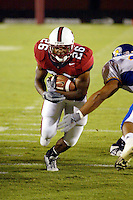 Kenneth Tolon scores a touchdown during Stanford's 63-26 win over San Jose State on September 14, 2002 at Stanford Stadium.<br />