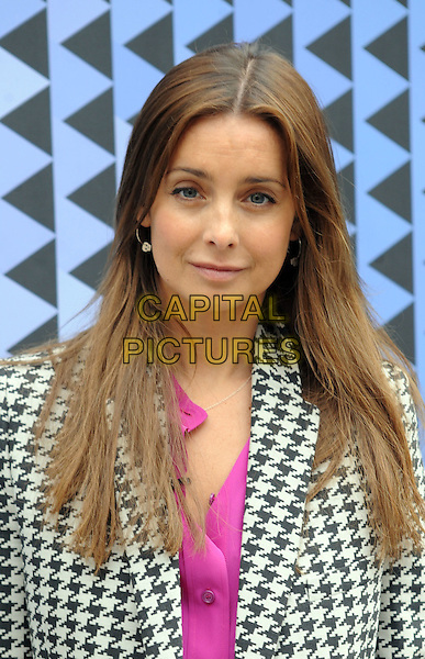 Louise Redknapp .at the Corrie Nielsen show during DAY 1 of London Fashion Week 2012, Somerset House, London, England, UK, .17th February 2012..LFW portrait headshot brunette hair  skull silver hoop earrings  black and white houndstooth blazer jacket pink top  shirt .CAP/WIZ.© Wizard/Capital Pictures.