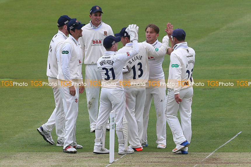Aaron Beard of Essex is congratulated by his team mates after taking the wicket of Nick Gubbins during Middlesex CCC vs Essex CCC, Specsavers County Championship Division 1 Cricket at Lord's Cricket Ground on 21st April 2017