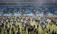 Coventry City supporters run onto the pitch to celebrate there team reaching the Wembley Final after of the The Checkatrade Trophy - EFL Trophy Semi Final match between Coventry City and Wycombe Wanderers at the Ricoh Arena, Coventry, England on 7 February 2017. Photo by Andy Rowland.