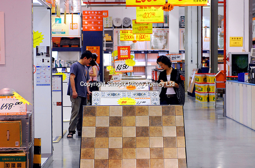 Customers in B & Q DIY store in Shenzhen, China. The British owned company, an offshoot of Kingfisher, opened a Shanghai store in 1999, and today it has 49 locations in China. By 2009, it aims to double that number..28 Apr 2006