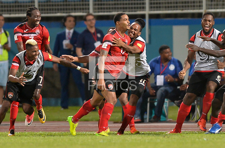 Couva, Trinidad & Tobago - Tuesday Oct. 10, 2017: Alvin Jones and Trinidad & Tobago score and celebrate during a 2018 FIFA World Cup Qualifier between the men's national teams of the United States (USA) and Trinidad & Tobago (TRI) at Ato Boldon Stadium.