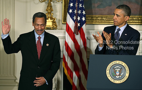 United States President Barack Obama congratulates U.S. Representative Mel Watt (Democrat of North Carolina) (L) after nominating him to be the next director of the Federal Housing Finance Agency during a personnel announcement at the White House May 1, 2013 in Washington, DC. Watt would be the first permanent director in nearly four years replacing Edward J. DeMarco for the housing regulator that oversees several  mortgage companies.  <br /> Credit: Mark Wilson / Pool via CNP