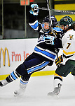 23 November 2011: University of Vermont Catamount forward Kailey Nash, a Senior from Middletown, RI, works against forward Tori Pasquariello, a Freshmen from Mississauga, Ontario, of the University of Maine Black Bears at Gutterson Fieldhouse in Burlington, Vermont. The Lady Bears defeated the Lady Cats 5-2 in Hockey East play. Mandatory Credit: Ed Wolfstein Photo