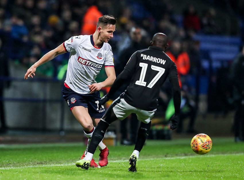 Bolton Wanderers' Pawel Olkowski passes under pressure from Reading's Modou Barrow  <br /> <br /> Photographer Andrew Kearns/CameraSport<br /> <br /> The EFL Sky Bet Championship - Bolton Wanderers v Reading - Tuesday 29th January 2019 - University of Bolton Stadium - Bolton<br /> <br /> World Copyright © 2019 CameraSport. All rights reserved. 43 Linden Ave. Countesthorpe. Leicester. England. LE8 5PG - Tel: +44 (0) 116 277 4147 - admin@camerasport.com - www.camerasport.com