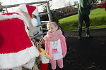 Redrow Homes<br /> <br /> Madison Bestwick with Father Christmas during his visit to Mon Bank Development.<br /> <br /> 22.11.14<br /> &copy;Steve Pope -FOTOWALES