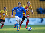 St Johnstone v Partick Thistle....17.01.15  SPFL<br /> Liam Caddis gets away from Dale Keenan<br /> Picture by Graeme Hart.<br /> Copyright Perthshire Picture Agency<br /> Tel: 01738 623350  Mobile: 07990 594431