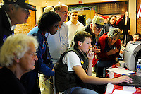 Everyone gathers around to see state by state election results as they come in on Joey Taylor's laptop at the GOP Headquarters on Main Street Tuesday night in Warrenton, VA.