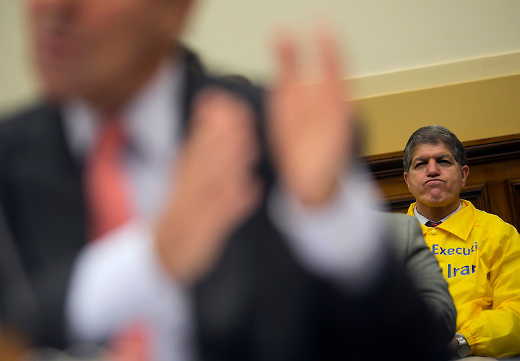 UNITED STATES - JULY 28: An activist listens as Secretary of State John Kerry testifies on Capitol Hill in Washington, Tuesday, July 28, 2015, before the House Foreign Affairs Committee hearing on the Iran Nuclear Agreement. (Photo By Al Drago/CQ Roll Call)