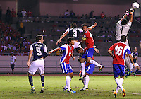 SAN JOSE, COSTA RICA - September 06, 2013: Matt Besler (5) and Omar Gonzalez (3) of the USA MNT lose the ball to Keylor Navas (1) of the Costa Rica MNT during a 2014 World Cup qualifying match at the National Stadium in San Jose on September 6. USA lost 3-1.