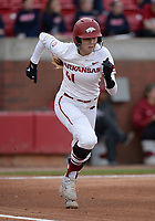 NWA Democrat-Gazette/ANDY SHUPE<br /> Arkansas designated hitter Danielle Gibson heads to first after connecting with the ball against Kentucky Friday, March 29, 2019, during the first inning at Bogle Park in Fayetteville. Visit nwadg.com/photos to see more photographs from the game.