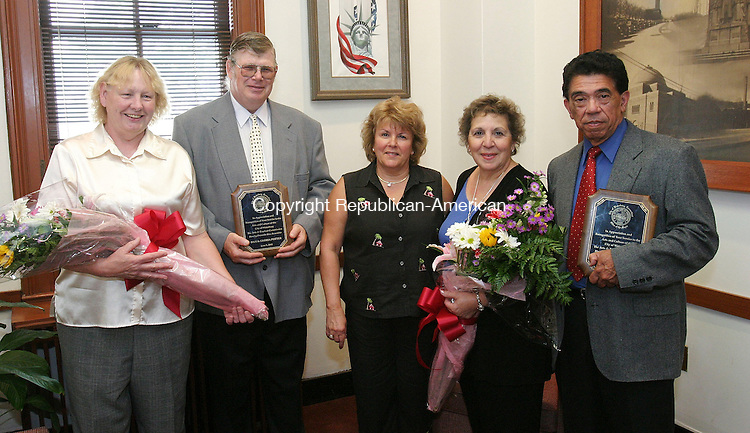 WATERBURY, CT - 08 June 2005 -060805BZ01- From left- Gloria Potter, Dan Potter, Barbara Sticco, chairman of the Arts and Tourism Commission, formerly the Mayors Council on Culture, Dolores Riollano, and Hector Riollano pose for photographs in the Mayors office Wednesday afternoon. The Potters and Riollano's are recipients of the 2005 cultural award from the commission.  The awards is given each year to an individual/individuals who unselfishly give to the growth and expansion of arts and culture in the region.<br /> Jamison C. Bazinet Photo