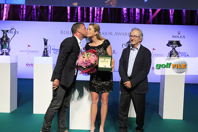 Jacques Bungert, Tournament Director, and Franck Riboud, CEO Evian, on stage with the new Evian Championship Ambassador Paula Creamer at the Rolex Annika Major Award Ceremony held in the La Grange du Lac after Saturday's Round 3 of The Evian Championship 2014 held at the Evian Resort Golf Club, Evian-les-Bains, France.: Picture Eoin Clarke, www.golffile.ie: 13th September 2014