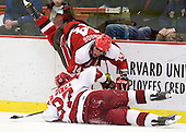 Nic Vangog (St. Lawrence - 14), Michael Biega (Harvard - 27) - The Harvard University Crimson defeated the St. Lawrence University Saints 4-3 on senior night Saturday, February 26, 2011, at Bright Hockey Center in Cambridge, Massachusetts.