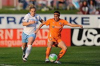 Brittany Taylor (14) of Sky Blue FC clears the ball away from Ella Masar (3) of the Chicago Red Stars. Sky Blue FC defeated the Chicago Red Stars 1-0 in a Women's Professional Soccer (WPS) match at Yurcak Field in Piscataway, NJ, on April 11, 2010.
