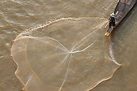 Fisherman fishing next to Japanese bridge, on Tonle Sap river, in Phnom Penh, Cambodia-2011