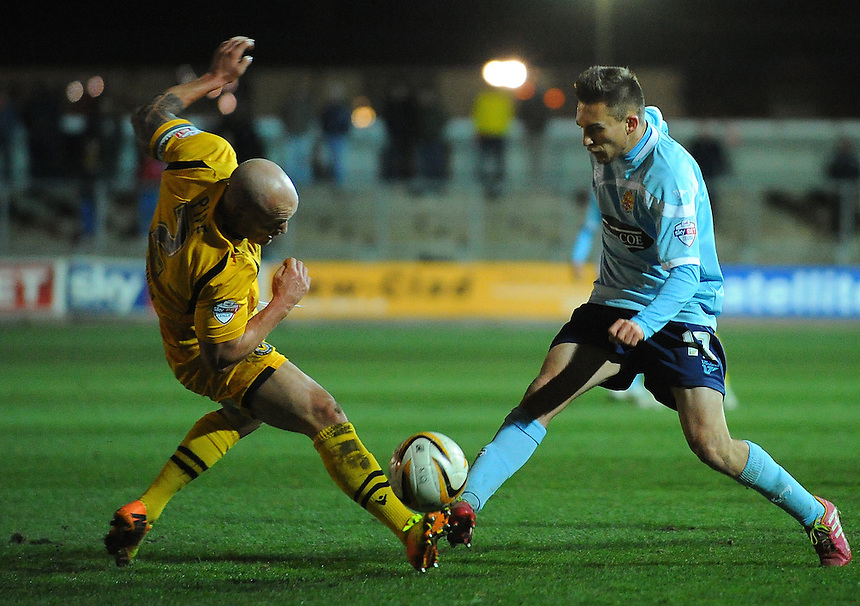 Dagenham and Redbridge's Lawson D'Ath is tackled by Newport County's David Pipe<br /> <br /> Photo by Kevin Barnes/CameraSport<br /> <br /> Football - The Football League Sky Bet League Two - Newport County AFC v Dagenham &amp; Redbridge - Wednesday 19th March 2014 - Rodney Parade - Newport<br /> <br /> &copy; CameraSport - 43 Linden Ave. Countesthorpe. Leicester. England. LE8 5PG - Tel: +44 (0) 116 277 4147 - admin@camerasport.com - www.camerasport.com