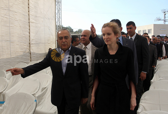 Palestinian Prime Minister Salam Fayyad and French Minister of Ecology, Sustainable development, transport, and housing, Nathalia Kosciusko- Morizet inaugurate a water pump in Maythalon village, near Jenin, the West Bank, 01 November 2011. Fayyad visited the village with Ms Kosciusko- Morizet to inaugurate the largest water supply scheme in the West Bank. The project reportedly cost 55 million shekels and was funded by France. Photo by Wagdi Eshtayah