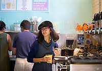 NWA Democrat-Gazette/JASON IVESTER<br /> Misa Fontana, 15, creats a bubble tea for a customer Thursday, May 25, 2017, during an open house for Anime Cafe in downtown Rogers.