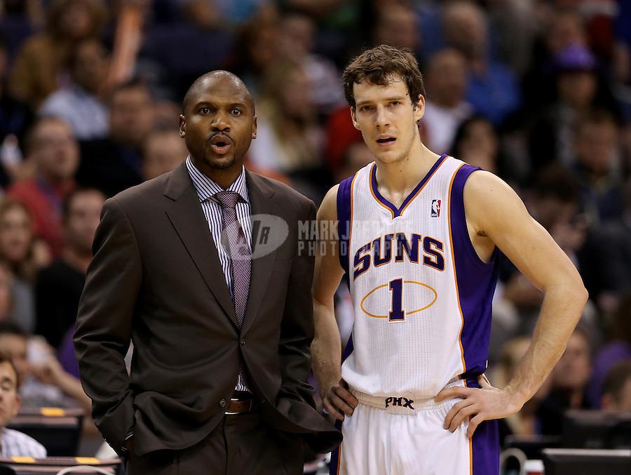 Jan. 24, 2013; Phoenix, AZ, USA: Phoenix Suns interim head coach Lindsey Hunter (left) and guard Goran Dragic react in the fourth quarter against the Los Angeles Clippers at the US Airways Center. The Suns defeated the Clippers 93-88. Mandatory Credit: Mark J. Rebilas-USA TODAY Sports