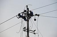 Men Working On An Electric Power Pole In Chongqing, China.  © LAN
