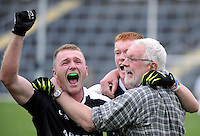 30-11-2014: Ardfert mentor and lcoal td Martin Ferris celebrates with players Shane Griffin and Brandon Barrett after their victory over Valley Rovers in the Munster GAA Club Intermediate Football final in Killarney on Saturday.<br /> Picture by Don MacMonagle XXJOB