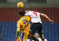 Bolton Wanderers' Christian Doidge competing with Wigan Athletic's Reece James<br /> <br /> Photographer Andrew Kearns/CameraSport<br /> <br /> The EFL Sky Bet Championship - Bolton Wanderers v Wigan Athletic - Saturday 1st December 2018 - University of Bolton Stadium - Bolton<br /> <br /> World Copyright © 2018 CameraSport. All rights reserved. 43 Linden Ave. Countesthorpe. Leicester. England. LE8 5PG - Tel: +44 (0) 116 277 4147 - admin@camerasport.com - www.camerasport.com
