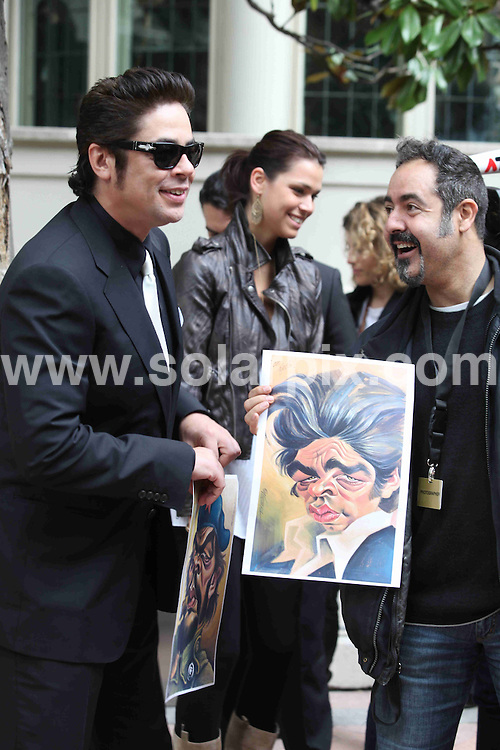 **ALL ROUND PICTURES FROM SOLARPIX.COM**.**WORLDWIDE SYNDICATION RIGHTS**NO PUBLICATION IN SPAIN**.Actor Benicio del Toro and actress Caroline Correa present the new Magnum Gold Ice Cream at the El Principal restaurant, Barcelona, Spain. 8 April 2010..This pic: Benicio del Toro being given a painting of himself..JOB REF: 11074 MER       DATE: 08_04_2010.**MUST CREDIT SOLARPIX.COM OR DOUBLE FEE WILL BE CHARGED**.**MUST NOTIFY SOLARPIX OF ONLINE USAGE**.**CALL US ON: +34 952 811 768 or LOW RATE FROM UK 0844 617 7637**