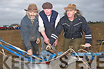 REPARING: Jim Cronin, Moss Trant and JJ Trant  reparing their plough before the start of the Abbeydorney Ploughing competition on Sunday.........