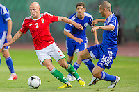 Hungary's Jozsef Varga (L) and Israel's Gil Naftali Vermouth (front R) fight for the ball during a friendly football match Hungary playing against Israel in Budapest, Hungary on August 15, 2012. ATTILA VOLGYI