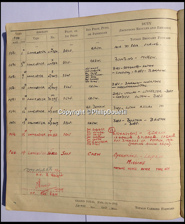 BNPS.co.uk (01202 558833)<br /> Pic: PhilipDouetil/BNPS<br /> <br /> ***Must use full byline***<br /> <br /> Barry Douetil's log book.  <br /> <br /> The remarkable story of how a free-falling RAF pilot was saved when the beam of a searchlight enabled him to locate his parachute has emerged for the first time.<br /> <br /> Squadron Leader Barry Douetil plunged out of his blazing Lancaster bomber at 20,000ft and was horrified when he realised his parachute wasn't strapped to his body.<br /> <br /> It was only when he hurtled for a split second through the bright beam of the German searchlight that he spotted it was on the end of a strap 10ft above him.<br /> <br /> While still falling through the air in the dark, the 21-year-old managed to rein the cord in until he was able to put the parachute on and pull the release cord in the nick of time.<br /> <br /> He landed heavily 10 seconds later in a frozen field but escaped the 1944 near-death experience with just a dislocated shoulder.