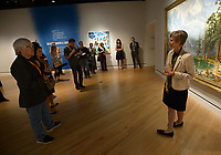 NWA Democrat-Gazette/ANDY SHUPE<br /> Mindy Besaw, Crystal Bridges Curator of American Art, speaks Thursday, Oct. 4, 2018, about a painting titled, &quot;History is Painted by the Victors,&quot; by artist Kent Monkman, during a tour of a new exhibition of artwork by Native American artists at Crystal Bridges Museum of American Art in Bentonville. The exhibition, titled &quot;Art for a New Understanding: Native Voices, 1950s to Now,&quot; opens today and runs through Jan. 7, 2019.