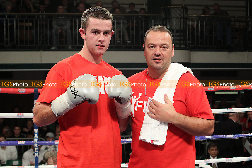 John Dignum (red shorts) defeats Joe Walsh in a Middleweight boxing contest at York Hall, Bethnal Green, London, promoted by Frank Warren - 01/11/12 - MANDATORY CREDIT: Gavin Ellis/TGSPHOTO - Self billing applies where appropriate - 0845 094 6026 - contact@tgsphoto.co.uk - NO UNPAID USE.