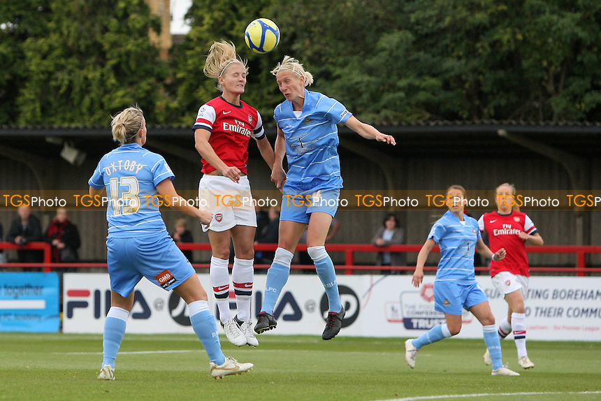 Katie Chapman in aerial action for Arsenal - Arsenal Ladies vs Doncaster Rovers Belles - FA Womens Super League Football at Boreham Wood FC - 30/09/12 - MANDATORY CREDIT: Gavin Ellis/TGSPHOTO - Self billing applies where appropriate - 0845 094 6026 - contact@tgsphoto.co.uk - NO UNPAID USE.