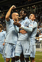 Sporting KC players Aurelin Collin, Kei Kamara, Davy Arnaud celebrate Kamara's opening goal... Sporting Kansas City defeat Columbus Crew 2-1 at LIVESTRONG Sporting Park, Kansas City, Kansas.
