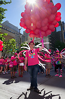 Man holding bunch of red balloons, Seattle PrideFest 2016, Pride Parade and Festival, Washington, USA.