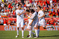 Santiago Cazorla (20) of Spain celebrates scoring a goal with teammates. The men's national team of Spain (ESP) defeated the United States (USA) 4-0 during a International friendly at Gillette Stadium in Foxborough, MA, on June 04, 2011.