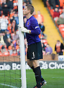 United keeper Radoslaw Cierzniak goes through a kissing the post ritual at the start of the second half   ...