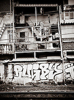 thailand, asia, transportation, travel, rail, culture mix, railroad, documentary, creative, people, religion, 2nd 3rd class, cars, buildings, abandoned, graffiti, windows, black & white