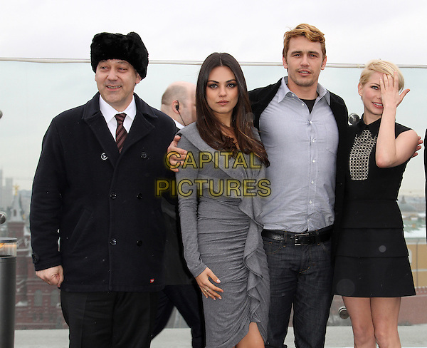 Sam Raimi, Mila Kunis, James Franco, Michelle Williams .'Oz: The Great and Powerful' Russian film premiere, Moscow, Russia..February 27th, 2013.half length black suit fur hat grey gray hand arm dress  ruffle tiered blue shirt jeans denim covering face .CAP/PER.©PersonaStars/CapitalPictures