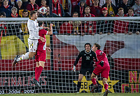 COLLEGE PARK, MD - NOVEMBER 15: Brett St. Martin #12 of Maryland climbs over Daniel Munie #5 of Indiana for a header during a game between Indiana University and University of Maryland at Ludwig Field on November 15, 2019 in College Park, Maryland.