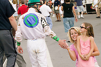 Jockey Julien Leparoux (2L) reaches out to touch the hand of a fan and her daughter after a race in Saratoga Springs, NY, United States, 4 August 2006.