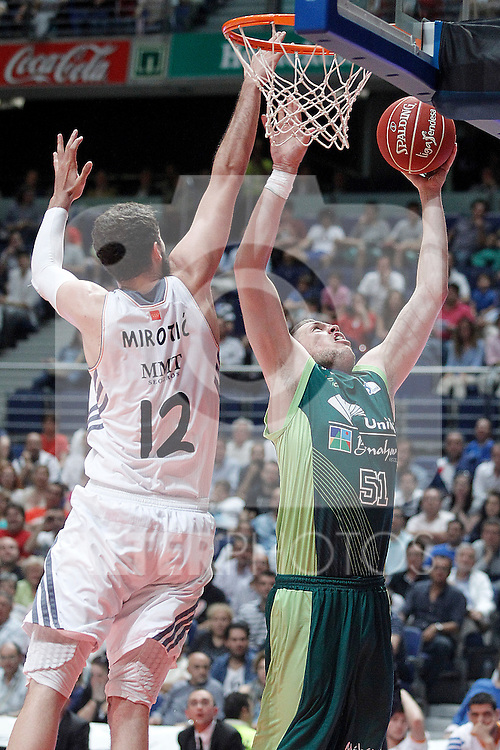 Real Madrid's Nikola Mirotic (l) and Unicaja's Nik Caner-Medley during Liga Endesa ACB Semifinal match.June 6,2014. (ALTERPHOTOS/Acero)