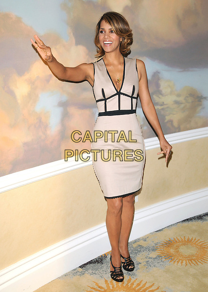 HALLE BERRY .at The Jenesse Silver Rose Gala & Auction held at The Beverly Hills Hotel in Beverly Hills, California, USA, .April 19th 2009                                                                     .full length grey gray beige dress black trim hand waving shoes sandals .CAP/DVS.©RockinExposures/Capital Pictures