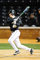 Luke Czajkowski (26) of the Wake Forest Demon Deacons follows through on his swing against the West Virginia Mountaineers at Wake Forest Baseball Park on February 24, 2013 in Winston-Salem, North Carolina.  The Demon Deacons defeated the Mountaineers 11-3.  (Brian Westerholt/Four Seam Images)