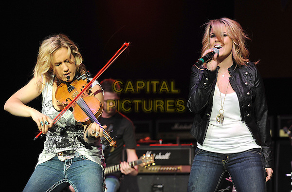 BOMBSHEL - Kristy Osmunson & Kelley Shepard.Performs live at the Grove of Anaheim in Anaheim, California, USA. .March 10th, 2010.stage concert live gig performance music half length black white top sleeveless print jacket singing violin .CAP/RKE/DVS.©DVS/RockinExposures/Capital Pictures.