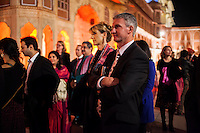 Guests stand in a royal courtyard dressed in 'hints of pink' while listening to a speech before a violin recital at the OzFest Gala Dinner in the Jaipur City Palace, in Rajasthan, India on 10 January 2013. Photo by Suzanne Lee