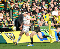 Northampton, England. Anthony Allen of Leicester Tigers in action during the Northampton Saints and Leicester Tigers  during the Aviva Premiership match at Franklin's Gardens, Northampton, England on March 29, 2014