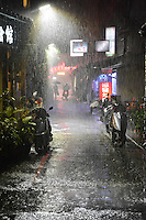"""""""Taipei Rain""""  by Art Harman. Standing under shelter at Taipei's night market, the heavens opened up, creating this view--highlighted by a lone streetlight."""